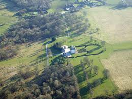 Ashdown House from the air, the Uffington, White Horse is on a hill about 3 miles to the right