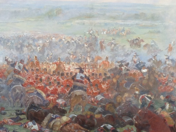 A picture of a painting of a square and the charge against it from The Lion Mount on the battle site