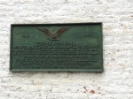 The plaque which commemorates the end of this terrible battle